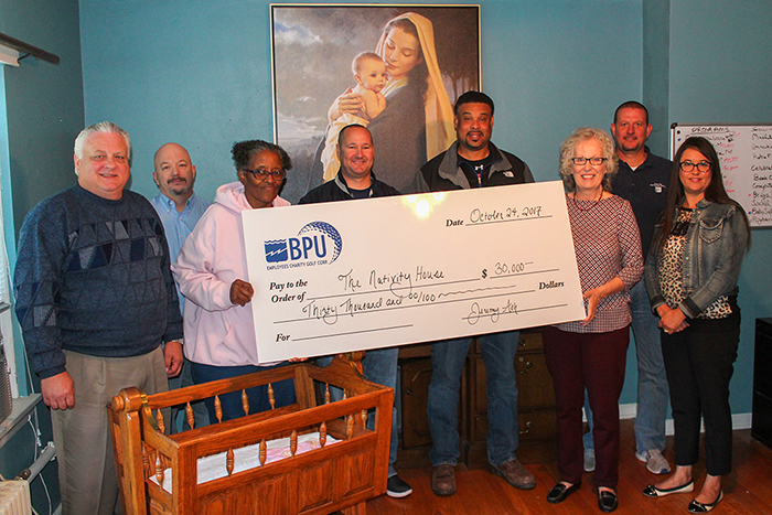 BPU employees present a check