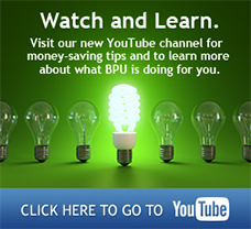 An efficient lightbulb illuminated in front of standard lightbulbs. Visit our new YouTube channel for money-saving tips and to learn more about what BPU is doing for you. Click here to go to YouTube